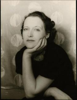 Marion Dorn pictured in front of the design Scallop Shell, photographed by Carl Van Vechten in 1936